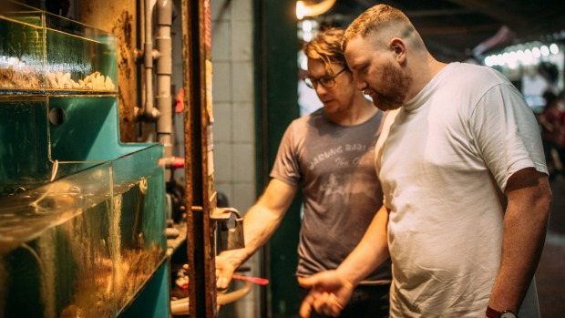 Patrick Friesen and Christopher Hogarth checking out the live seafood tanks as they wander around the dai pai dongs.