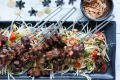 Neil Perry's pork skewers with green papaya salad.