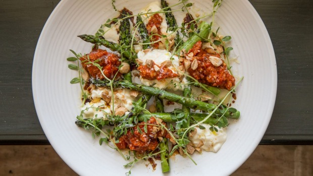 Stracciatella and grilled asparagus with romesco sauce at Union Dining.