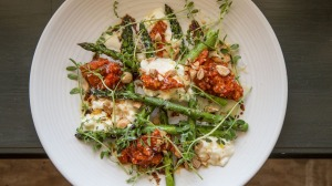 Stracciatella, grilled asparagus, romesco sauce, almonds and saba served at Union Dining in Richmond.