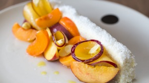 Josh Niland's vanilla coconut cake with stone fruit and green almonds.