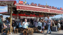Rick Stein eating Istanbul's famous fish sandwich, balik ekmek, in his TV series 'Rick Stein: From Venice to Istanbul'.