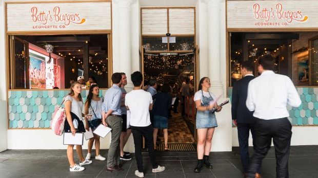 A queue forms outside Betty's Burgers, 97 Elizabeth Street, Melbourne.