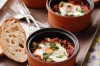 Baked eggs with tomato, parsley and chorizo. <a ...