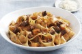 Pappardelle with lamb and pumpkin in red wine and garlic sauce.