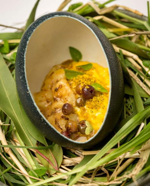 Emu's Egg (emu egg shell filled with scrambled hen's egg, emu floss, potato, pineapple sage leaves and native muntries)  ...