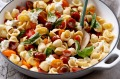 Orrechiette with cherry tomatoes, basil and pine nuts.