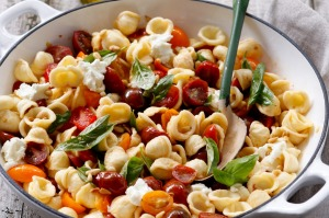 Summer pasta with cherry tomatoes, basil and pine nuts.