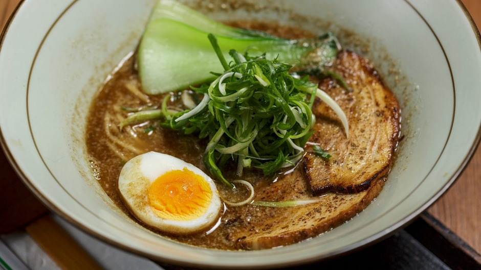 Black ramen with pork, bok choy and egg.
