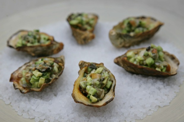 Oysters with tea-smoked salsa. <a ...