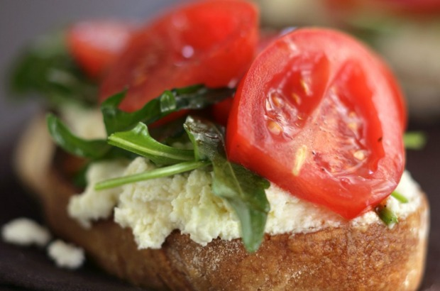 Ricotta (flavoured with extra-virgin olive oil & parmesan) on toast with tomatoes & rocket. <a ...