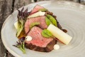 Local grass-fed beef is on the menu at Homage restaurant, Hidden Vale.