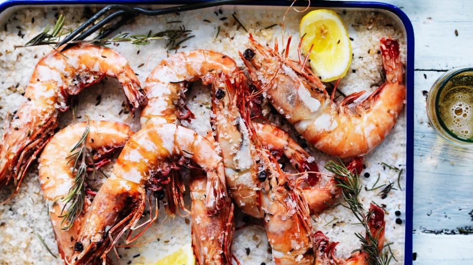 Barbecue prawns on the grill for a few minutes each side until they change colour.