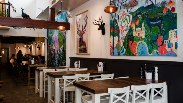 Bench seating and bright artworks are part of the rejuvenated Elk and Pea.