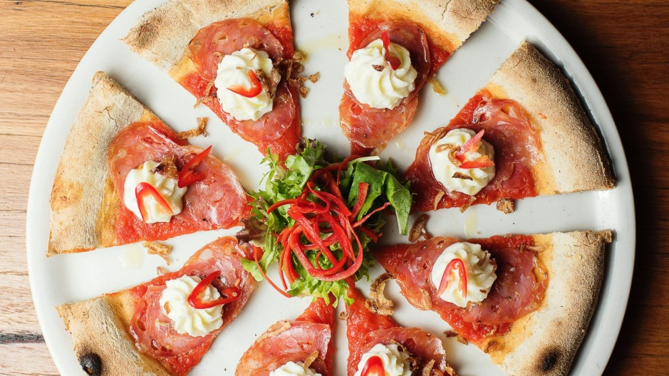 Diavola pizza with piped cheese and spicy salami.