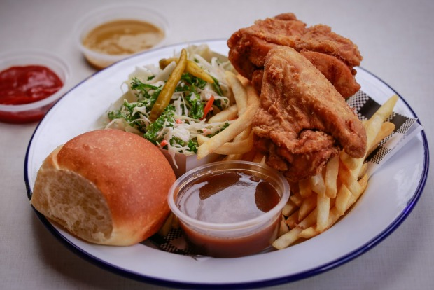 Fried chicken served with fries, coleslaw, bread and gravy at Juanita Peaches.