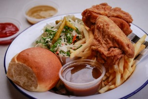 Fried chicken served with  fries, coleslaw, bread and gravy.