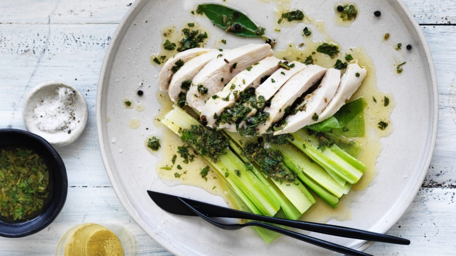 Champagne-poached chicken and leeks with summer herb butter.