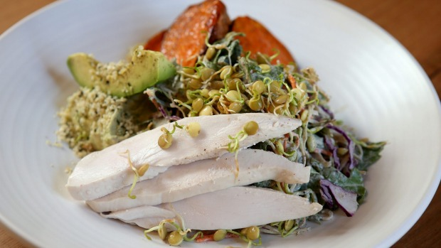 Go-to dish: Sweet potato, chicken, avocado hummus, sprout and cabbage slaw with nut milk dressing.
