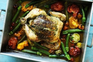 Rachel Khoo's roast chicken with herb butter and summer vegetables.