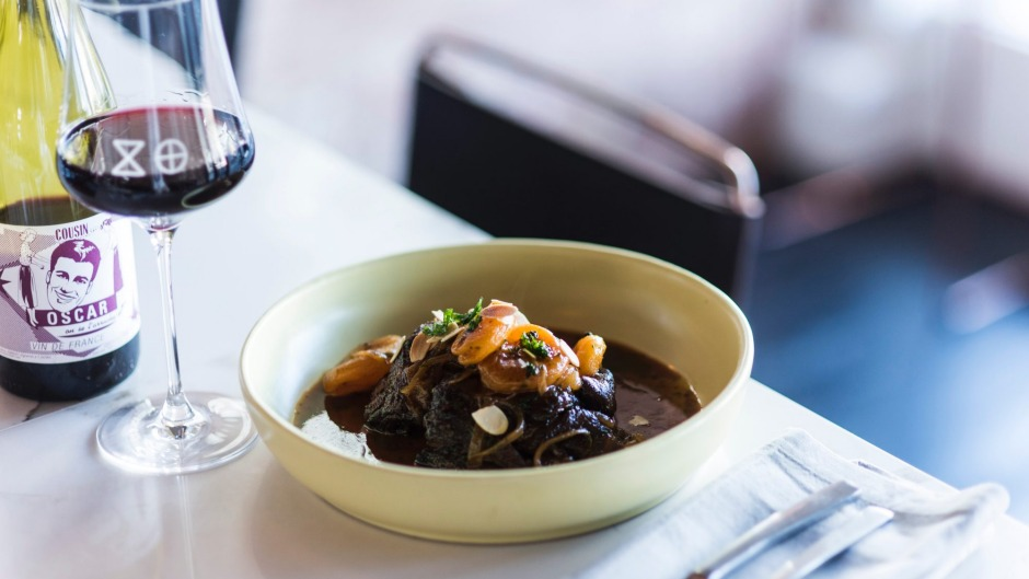 Slow-cooked goat with caramelised onions and apricots.