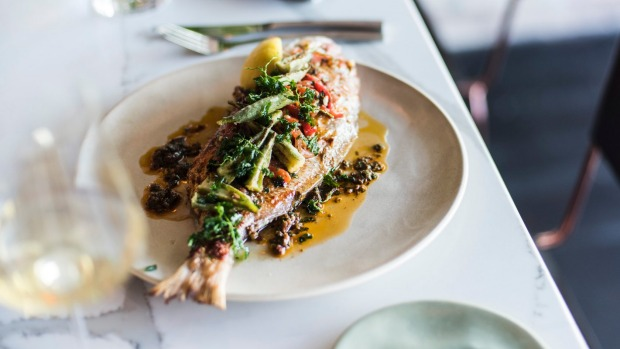 Whole baked snapper with chermoula and okra.