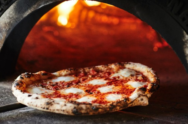 Wood-fired pizza at Cucina and Co in Brighton.