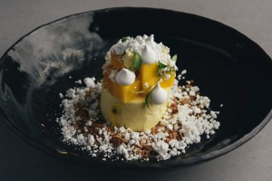 Mango mousse with coconut, passionfruit and white chocolate.