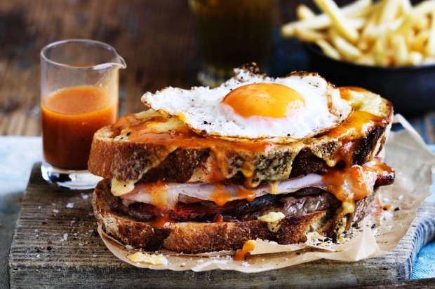 Portugal's Francesinha is a meat-filled monster topped with egg and cheese, smothered in a beer-based sauce and served ...