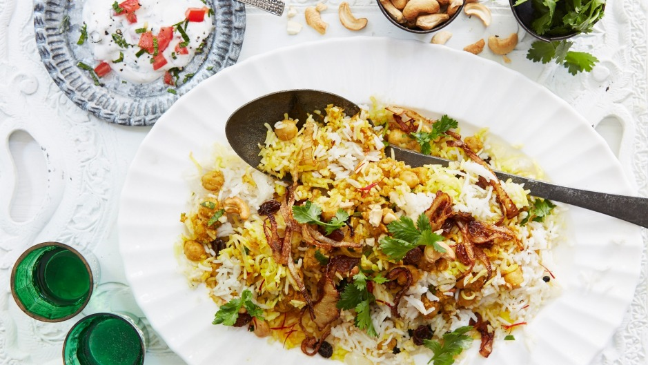 Chickpea biryani topped with crispy onions and cashews.