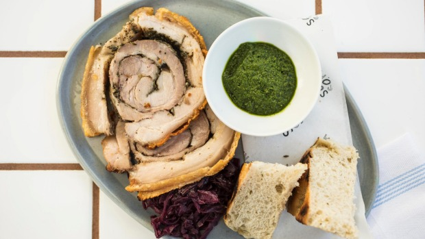 Wood-oven roasted porchetta with red cabbage and salsa verde.