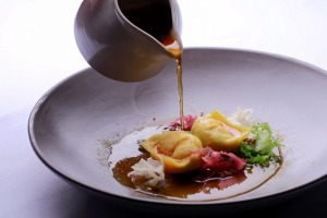 Scallop dumplings with soy mirin broth.
