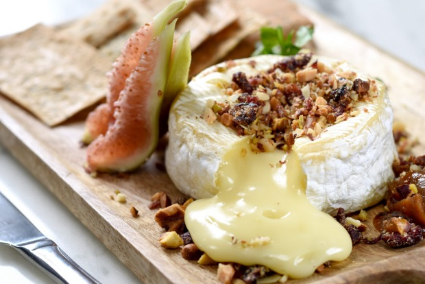 Put a whole wheel of camembert in the oven and bake it until it's extra gooey. <a ...