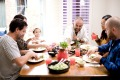 How do families turn the dining room into a warmer family-friendly space?