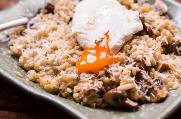 Autumn mushroom risotto with a poached egg. <a ...