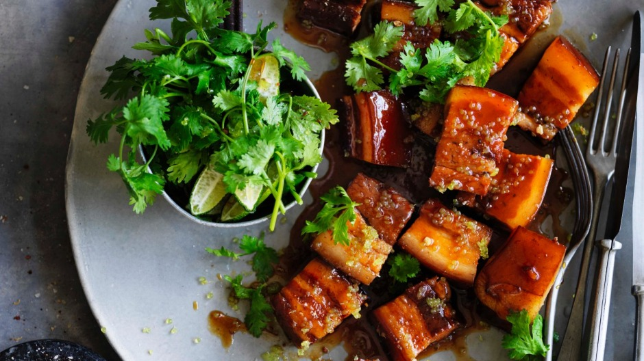 Red braised caramelised pork belly with fresh finger limes.