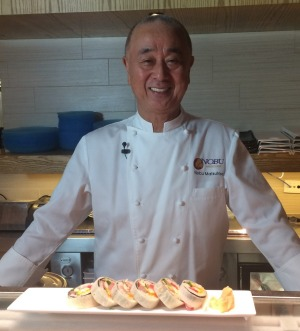 Chef Nobu poses with his Melbourne cut sushi roll.