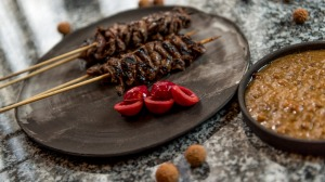Ben Shewry's Australian-flavoured satay with kangaroo and macadamia nuts.