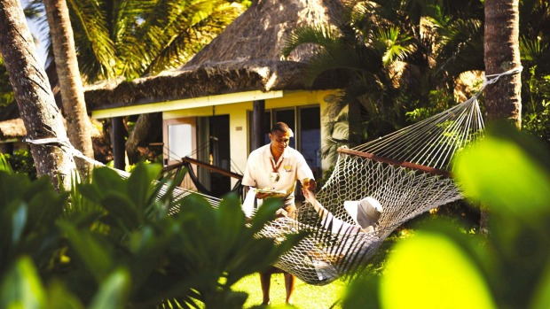 Relaxing outside a bure (private cabin) at Outrigger Fiji Beach Resort.