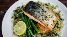 Pub classics include the pan roasted salmon.