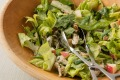 Green salad with chicken, apple and maple walnuts in buttermilk dressing.