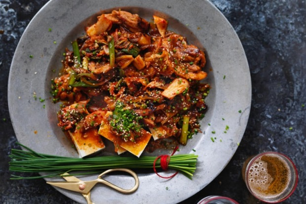 Neil Perry's pork belly and kimchi stir-fry with tofu. <a ...
