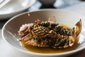 Roasted Moreton Bay bugs in a pool of herb butter.