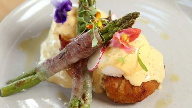 Eggs benedict with jamon-wrapped asparagus spears.