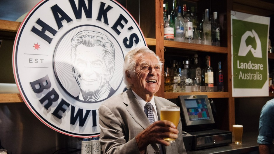Bob Hawke pours a glass of his namesake brew.