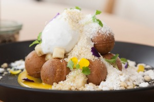 Belgian waffle balls with passionfruit cream, banana crumb and pandan ice-cream at Abbotsford cafe AU79.