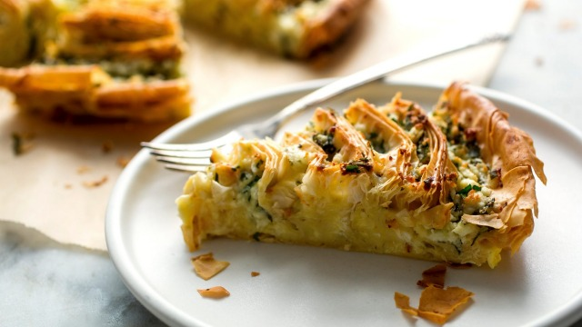 A slice of feta and herb filo tart.