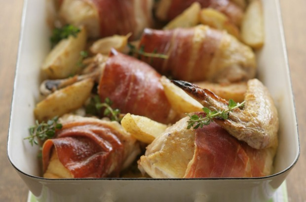 One-pan wonder: Quick prosciutto-wrapped roast chicken with potato wedges <a ...