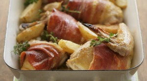 One-pan wonder: Quick roast chicken with prosciutto and potato wedges.