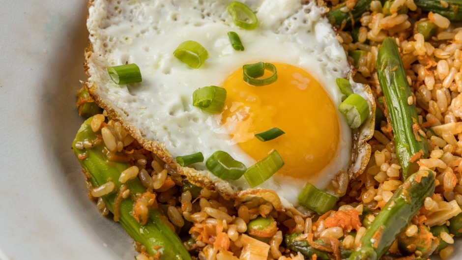 Put an egg on it: Sesame fried (brown) rice with vegetables and fried egg.